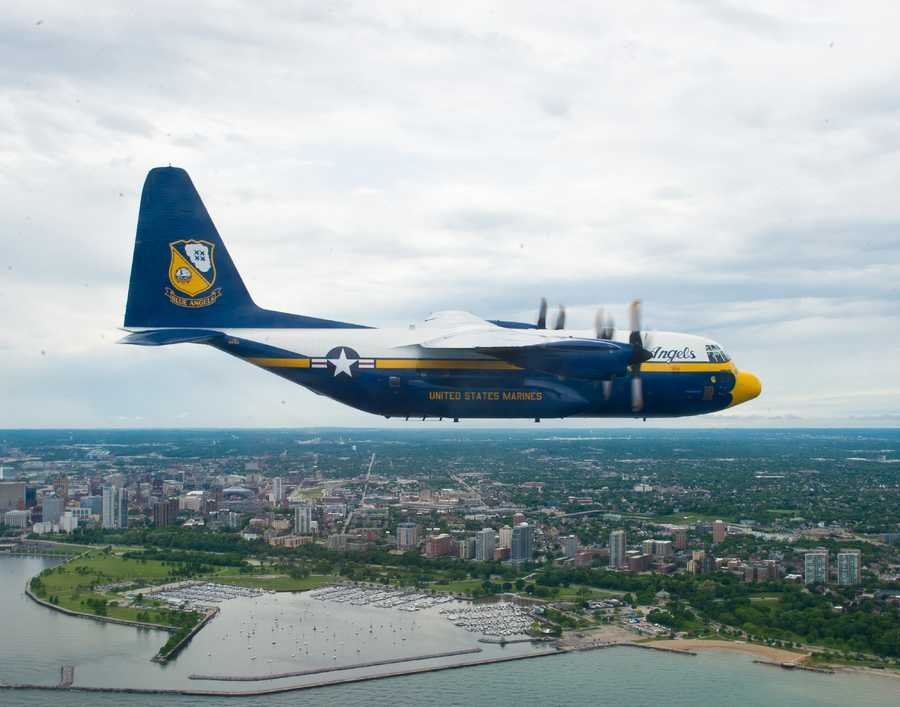 """The C-130 affectionately known as """"Fat Albert"""" and assigned to U.S. Navy flight demonstration Squadron, the Blue Angels, is flown over Lake Michigan off the coast of Milwaukee for a scheduled team photo shoot. The Blue Angels are scheduled to fly in 68 performances at 35 locations this year."""