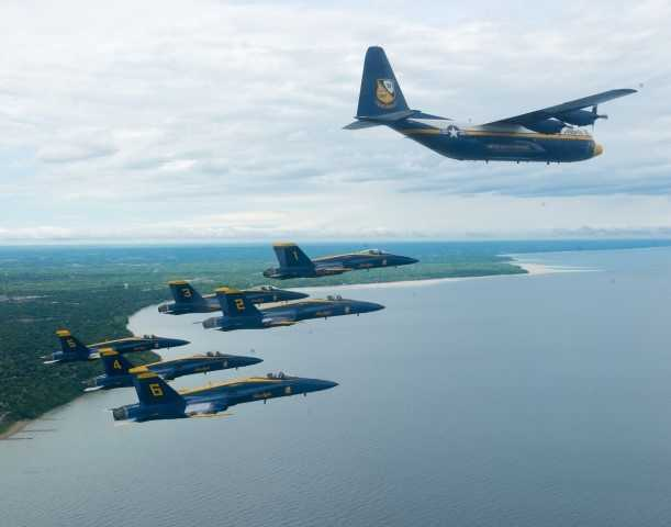 "Pilots assigned the U.S. Navy flight demonstration Squadron, the Blue Angels, fly their F/A-18s and their C-130, affectionately known as ""Fat Albert"", in formation over Lake Michigan off the coast of Milwaukee for a scheduled team photo shoot. The Blue Angels are scheduled to fly in 68 performances at 35 locations this year."