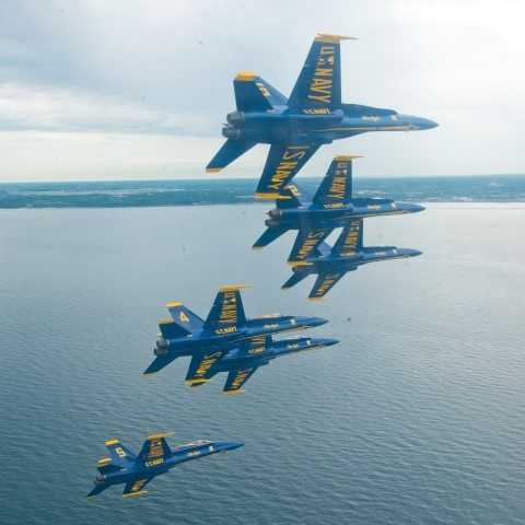 Pilots assigned the U.S. Navy flight demonstration Squadron, the Blue Angels, fly their F/A-18s in the Delta formation over Lake Michigan off the coast of Wisconsin between Chicago and Milwaukee for a scheduled team photo shoot. The Blue Angels are scheduled to fly in 68 performances at 35 locations this year.