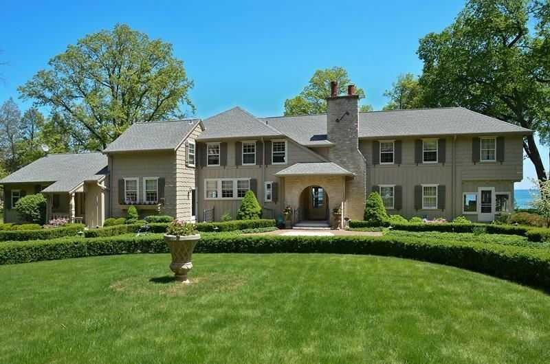 Built in 1927, this home has six bedrooms and four baths spread over 5,400 square feet of living space. It has 250 feet of shoreline on Lake Michigan. For more information on this property, click here.