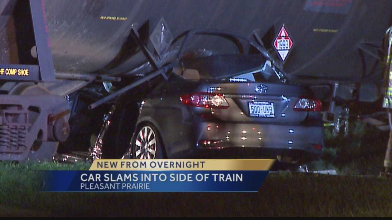 A man has been hospitalized after wedging his car underneath a parked train in Kenosha County Thursday.