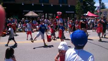 Little Leaguers tossing candy in the Whitefish Bay parade