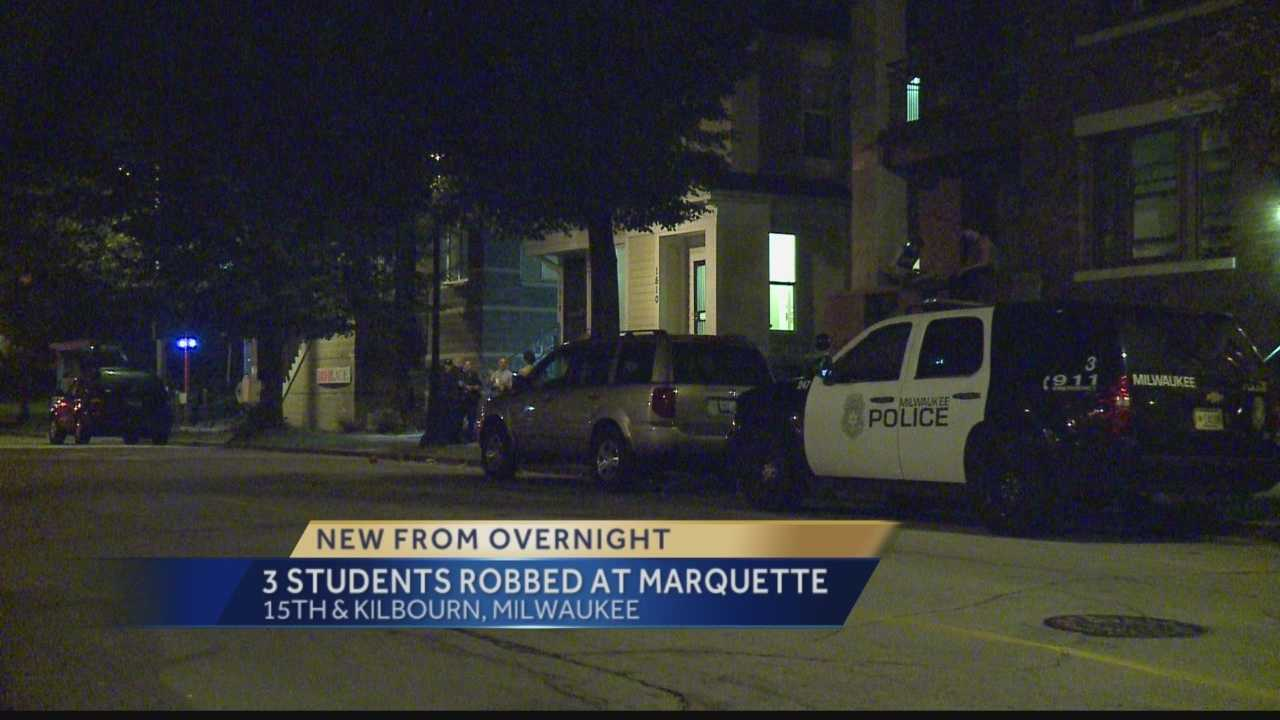 Milwaukee police are looking for four people who robbed students near Marquette university overnight.