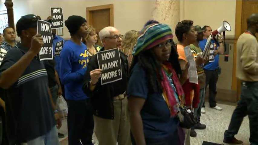 The stood in front of Milwaukee Mayor Tom Barrett's office, demanding to talk to him, but he wasn't there.