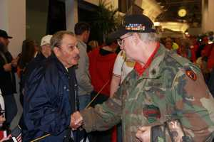 """Harvey Kurz, one of the stars of the documentary """"Honor Flight"""", is on hand to welcome home the vets."""