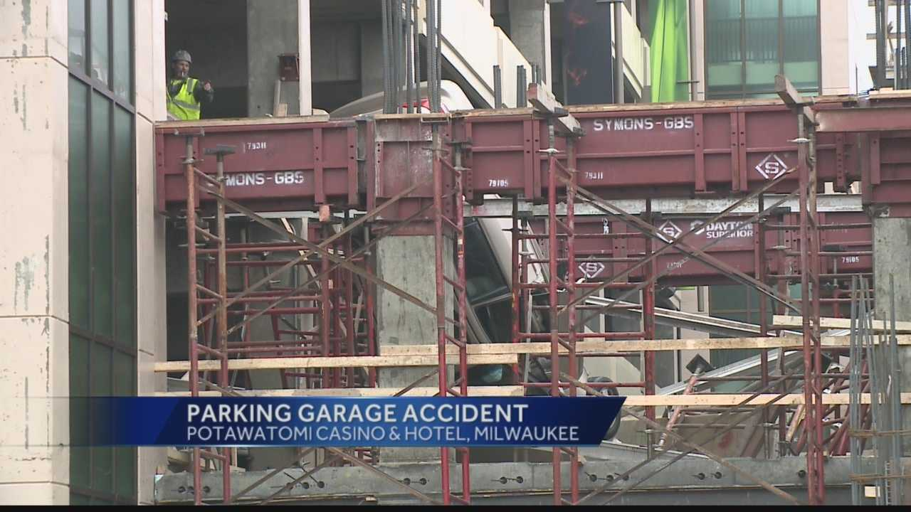 The car landed on construction scaffolding near the parking garage.