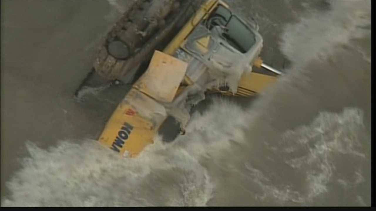 A half million dollar Earth mover covered in waves and icicles  seen on the Oak Creek shoreline