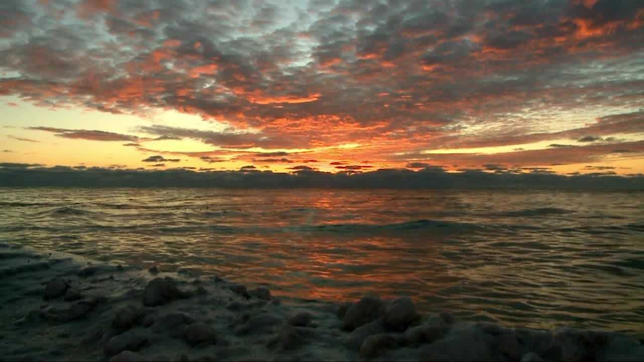 Photojournalist Dave Bakken captured a beautiful sunrise over a very cold Lake Michigan Wednesday morning.