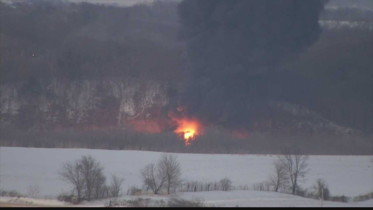 A train carrying a load of crude oil train cars continues to burn in northern Illinois.