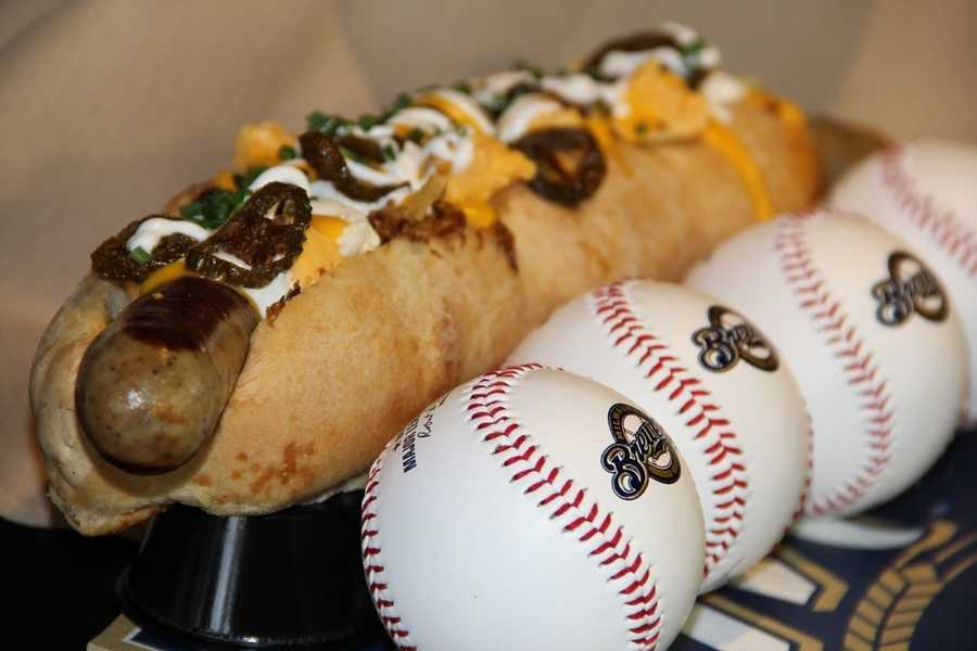 """""""The Down Wisconsin Ave. Brat"""" an 18 inch bratwurst, gravy, shoestring fries, cheese curds, fried sauerkraut, cheese sauce, fried jalapenos, sour cream and chives. It is long as 4 baseballs."""