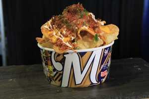 """""""Miller Park Bratchos"""": Kettle chips, Klement's Three Grind Sausage, nacho cheese, pico de gallo, sauerkraut."""