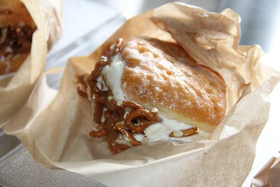 """""""Goober Jobber""""- Pretzels, peanuts, salted caramel, peanut butter and custard inside a glazed doughnut."""