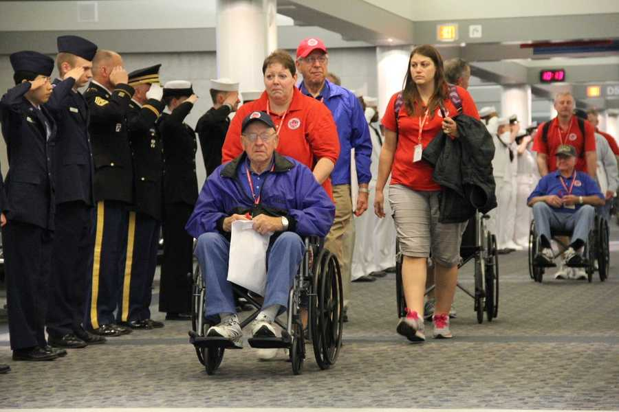 Each veteran is paired with a guardian for the day (red shirts). Sometimes they are a family or friend and sometimes a complete stranger.