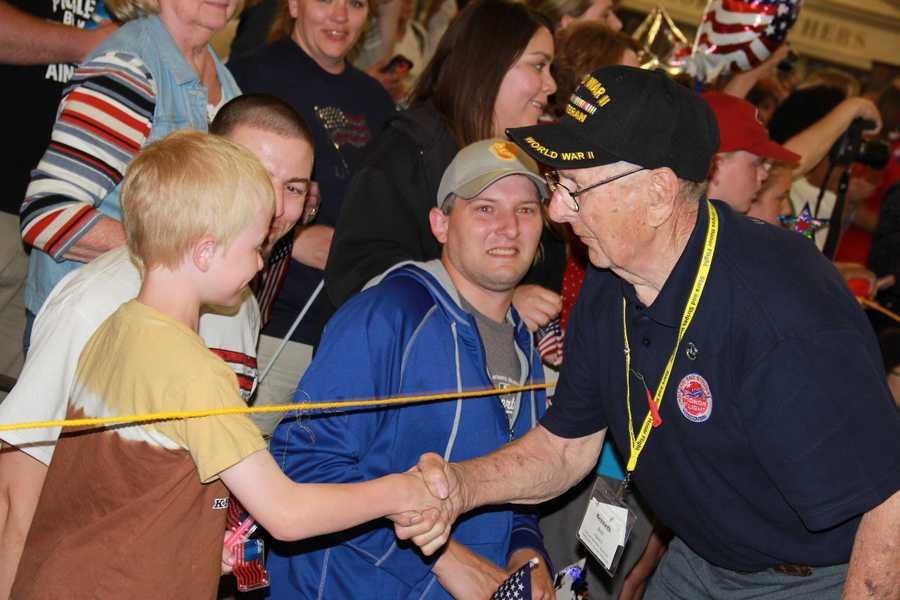 Dark blue shirts denote WWII veterans.