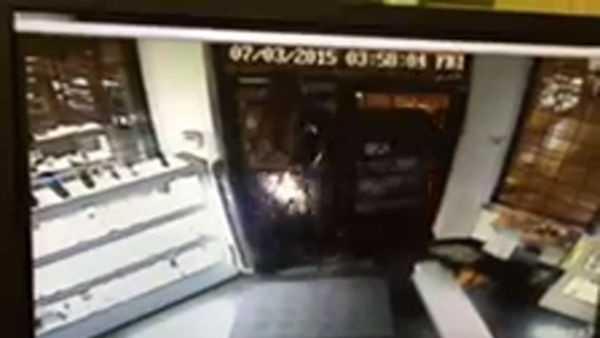 Surveillance video shows a minivan smashing into Bouchard's.