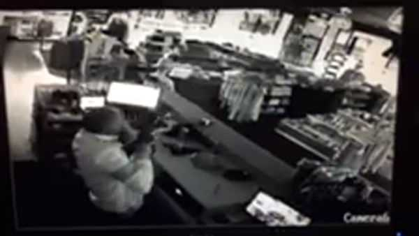 Surveillance video show a Milwaukee man defending his store against a brazen break-in by would-be burglars.