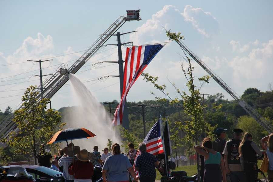 A water cannon salute and huge flag were among the first sights for the vets upon returning to Coal Dock Park.