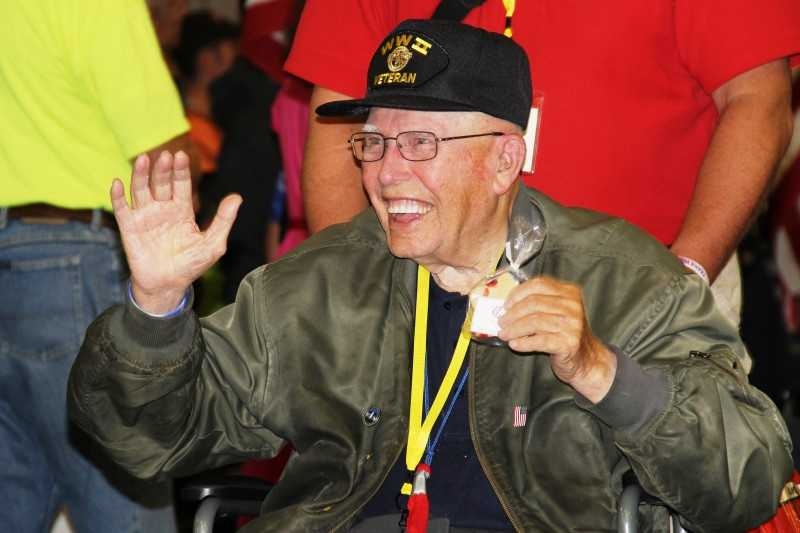 The airport was full of smiles on Saturday as the latest Stars and Stripes Honor Flight returned from a one-day trip to Washington D.C. to see the memorials built in the vets honor.