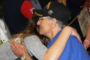 Friends, family and well-wishers filled the airport to welcome home 183 WWII and Korean War vets who had just returned from a trip to Washington D.C.
