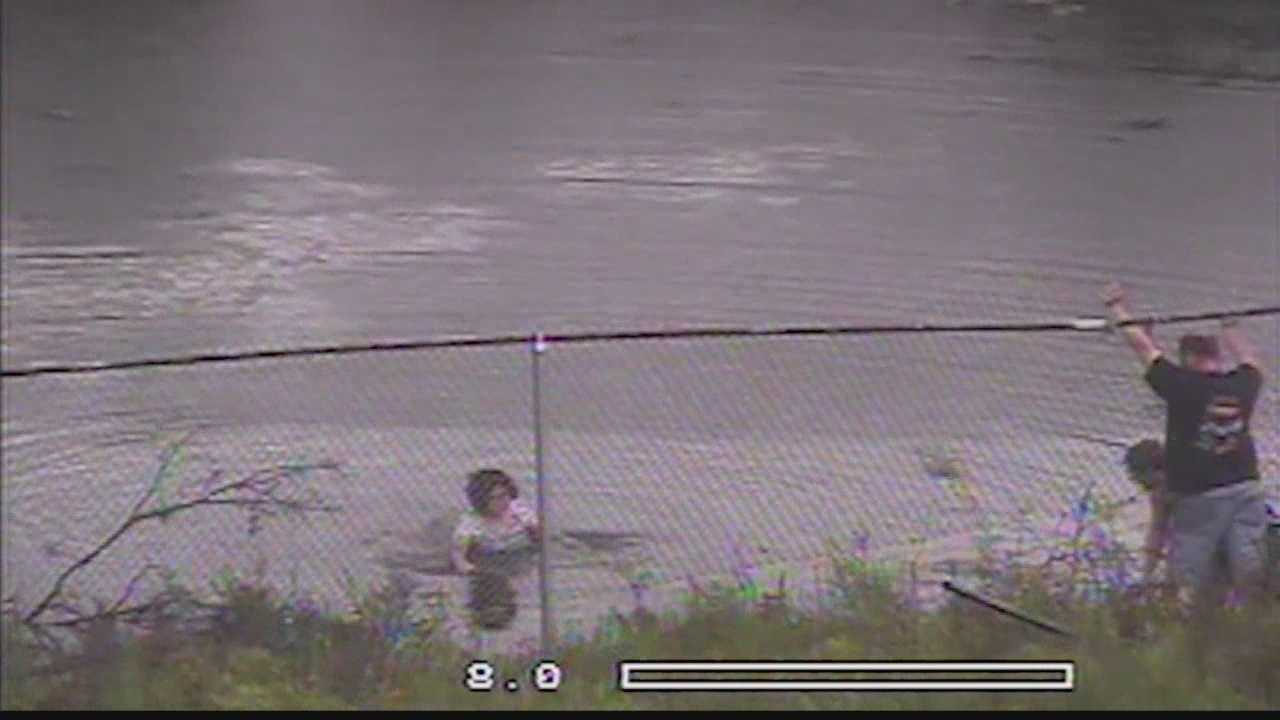 Man runs into Whitnall pond to help rescue woman from her vehicle.