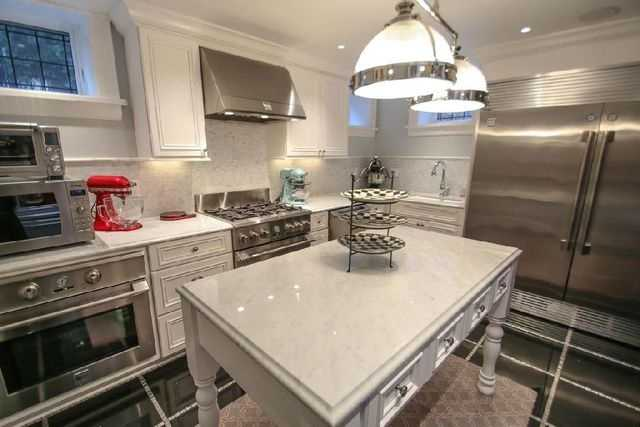 An entertainer's dream, the chef's kitchen features top-of-the-line appliances plus butler's pantry and catering kitchen in lower level.