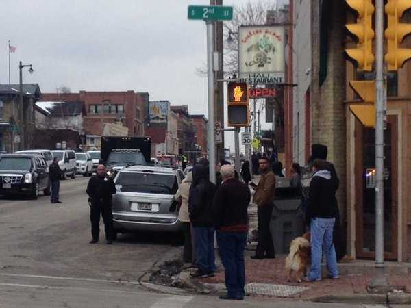 People waited for motorcade at Second Street and National Avenue.