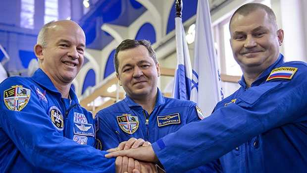 Expedition 47 crew members NASA astronaut Jeff Williams, and cosmonauts Oleg Skripochka and Alexei Ovchinin of the Russian space agency Roscosmos pose for a photograph before their Soyuz qualification exams Wednesday, Feb. 24, 2016, at the Gagarin Cosmonaut Training Center in Star City, Russia.