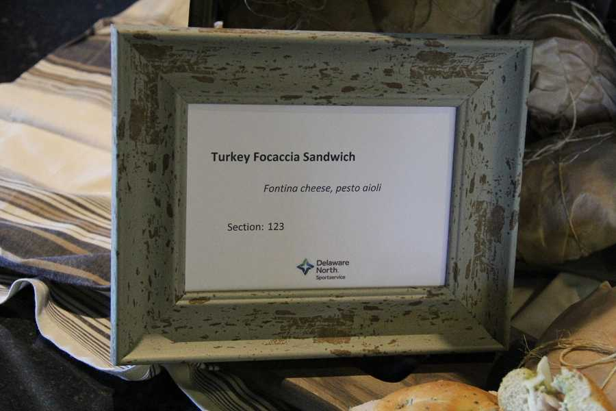 The Turkey Focaccia Sandwich has Fontina cheese and pesto aioli and can be found in section 123.