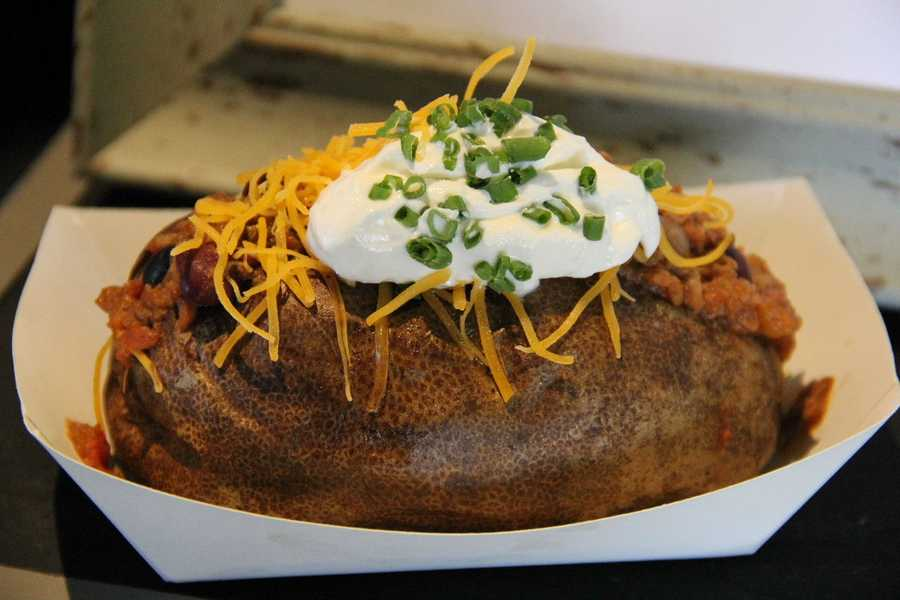 Is this just a baked potato?  No, this is the Racing Sausages chili loaded potato!