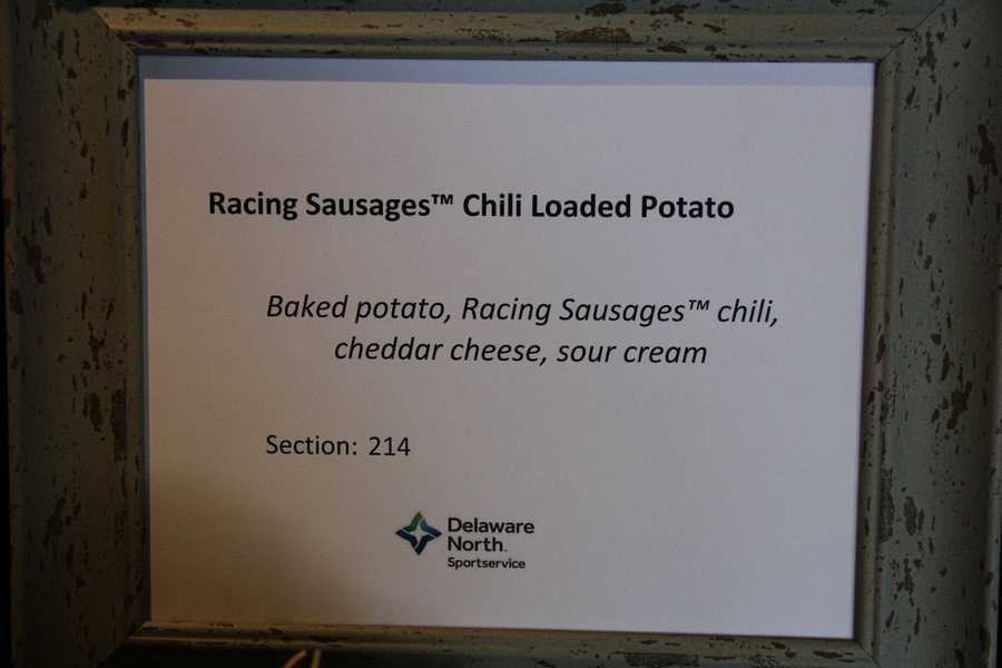 A baked potato topped with Racing Sausages chili, cheddar cheese and sour cream.  This can be found in section 214.