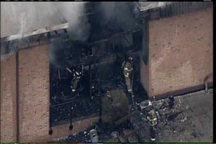 An apartment building at 57th Street and Oklahoma Avenue catches fire Tuesday afternoon.