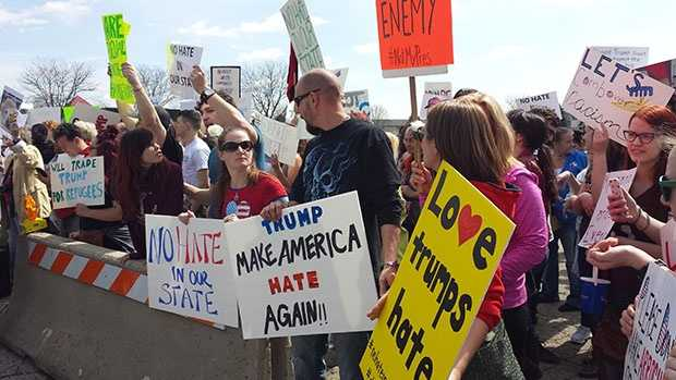 Protesters gather outside a Holiday Inn in Janesville on Tuesday, March 29, 2016 ahead of Donald Trump's planned visit.