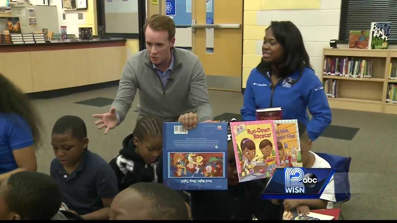 Ben Wagner and Melinda Davenport visited the Boys and Girls Club to emphasize the importance of reading.