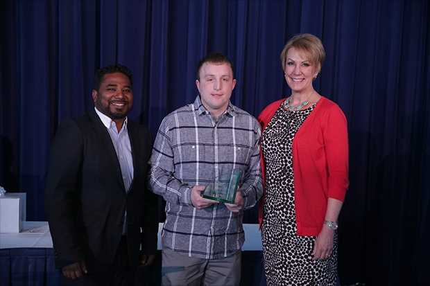 Justin Belot (center) of Barack Obama School of Career and Technical Education was the Top Teacher of May 2016.