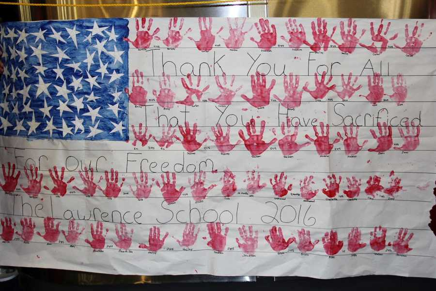 """""""Thank you for all that you have sacrificed for our freedom"""". This sign at the latest Stars and Stripes Honor Flight Homecoming sums up the sentiment felt by the thousands that gathered to welcome home 140 veterans from their one-day trip to Washington D.C."""