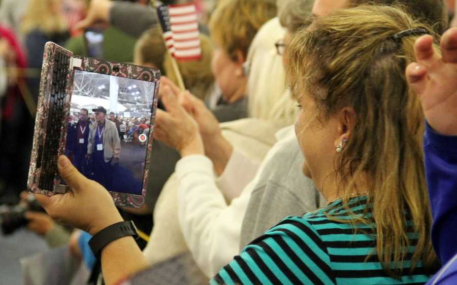 Family members want to take pictures and video of the event so they can remember the amazing feeling of patriotism that has filled the airport.