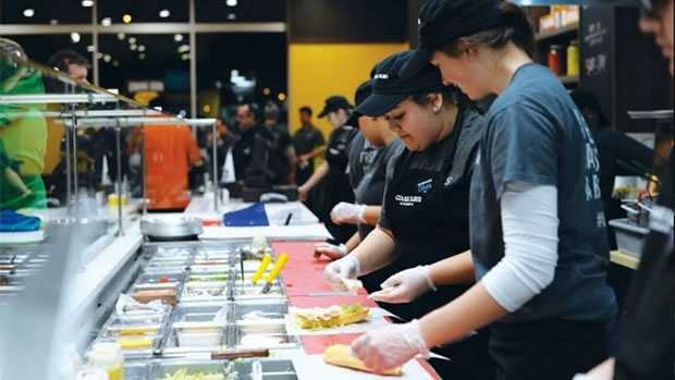 """Customer ordering is changing too. The new """"assembly line ordering process"""" will allow customers to personalize their orders, the company said."""