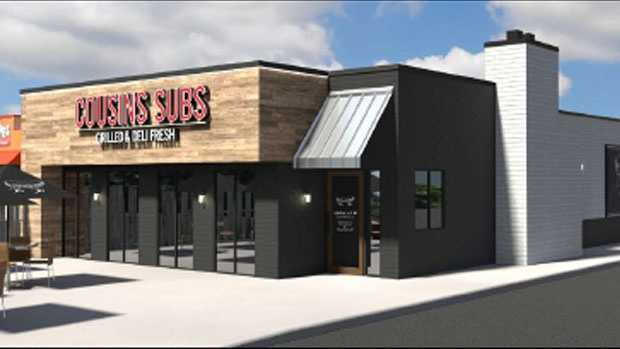 """Stores will have a wood door with window graphics that say """"local at heart,"""" the company said."""