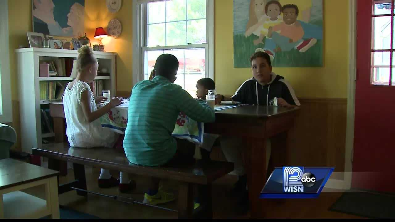 Family adopts foster children ranging in age from 5 to 16.