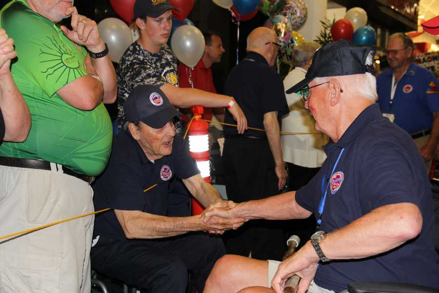 "Harvey Kurz (left), one of the stars of ""Honor Flight: The Movie"" is on hand at each homecoming to welcome home fellow vets."