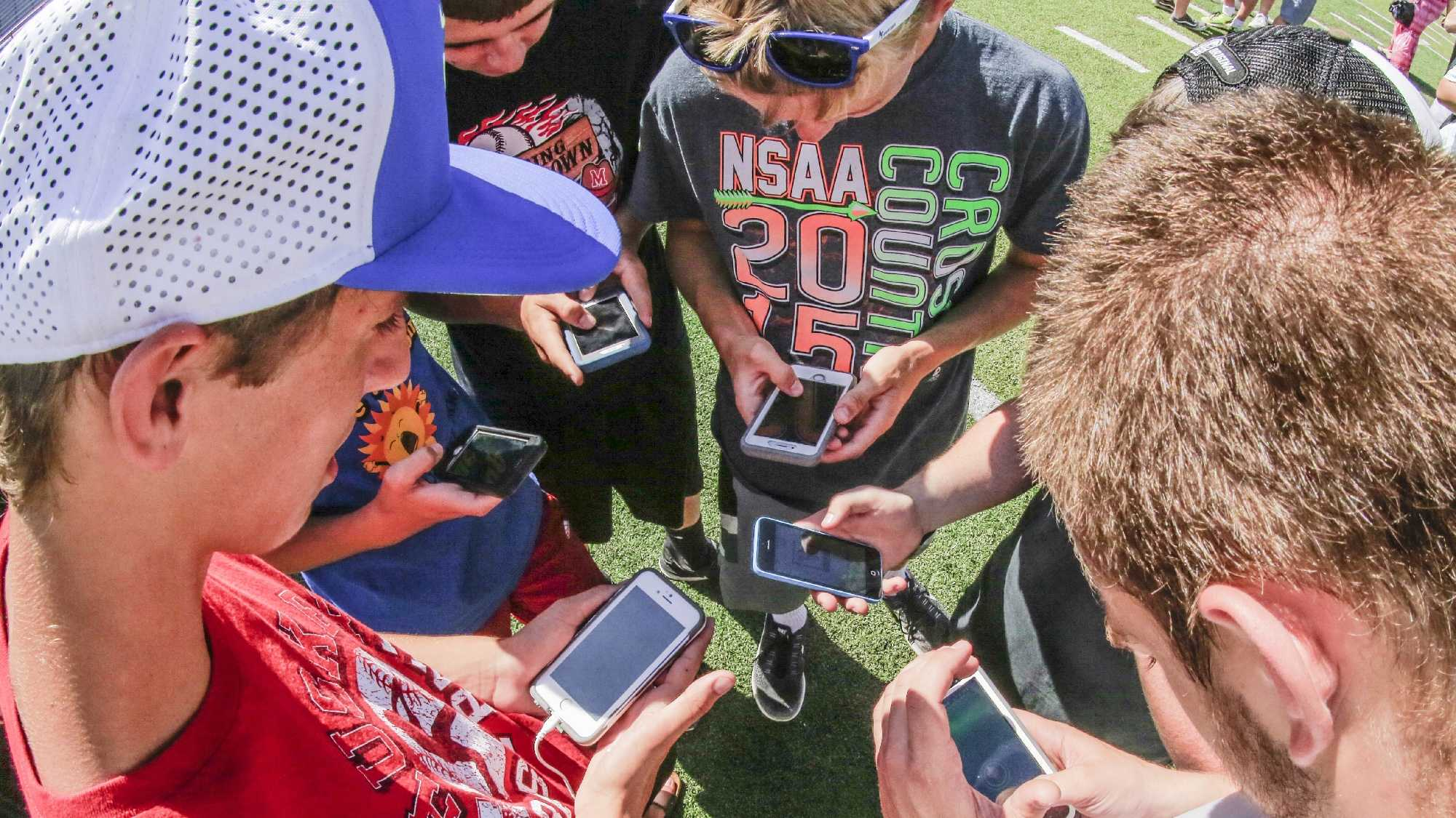 "Players congregate during a ""Pokemon Go"" event."