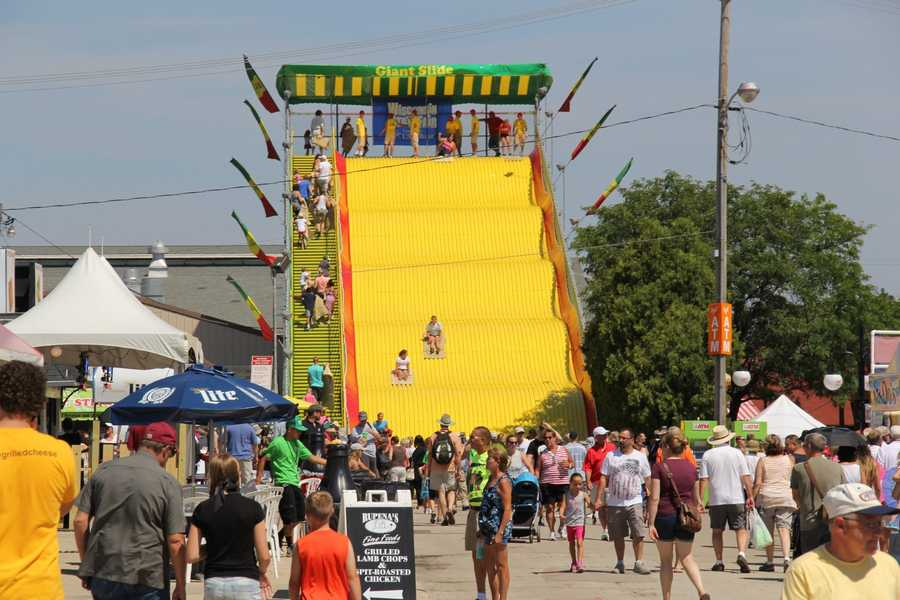 """The iconic """"Giant Slide"""" has a steady line of people waiting to ride."""