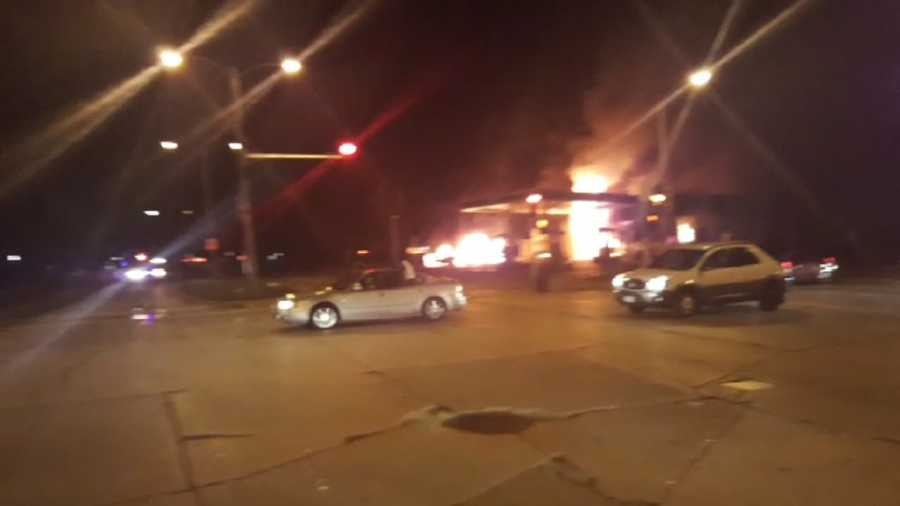 A BP gas station at North Sherman Boulevard and West Burleigh Avenue burns.