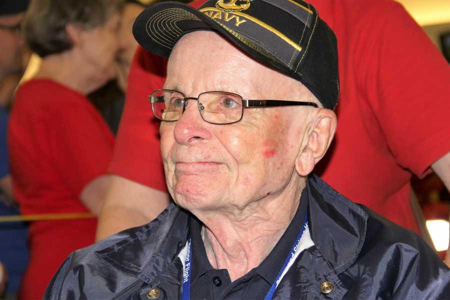 Dark blue shirts/jackets denote WWII vets.