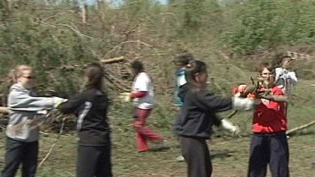 Several area students spend their spring break volunteering to do tornado cleanup work in Henryville.