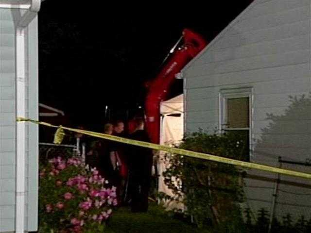 New Albany authorities dig in the yard at William Clyde Gibson's home before the body of Stephanie Kirk was found.
