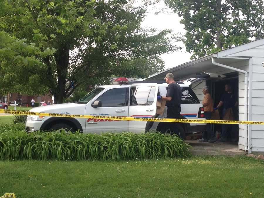 Investigators bring bags out of the home of William Clyde Gibson in May 2012.