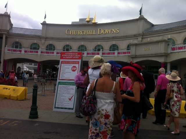 Early crowds going through security on Oaks Day.