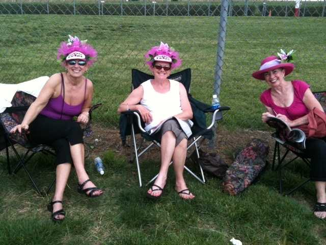 """A trio of ladies sporting """"Save the Tatas"""" hats in the infield for Oaks Day."""