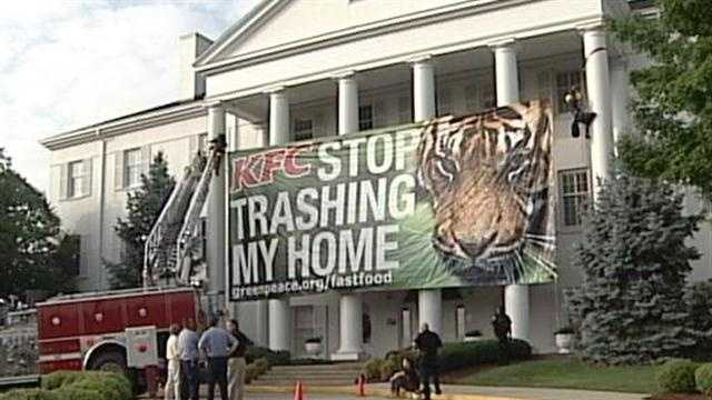 In a news release, Greenpeace says the banner is in protest against KFC's use of rainforests to make its packaging.